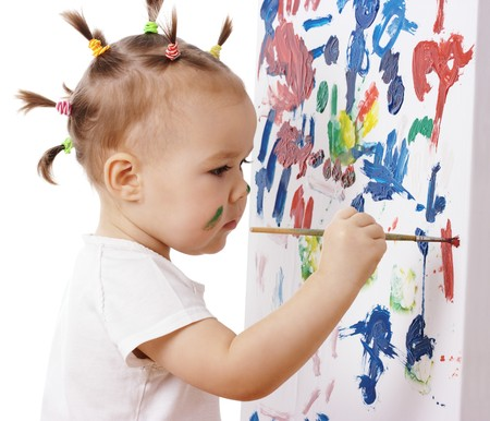 messy paint: Little girl paint on a board, isolated over white Stock Photo