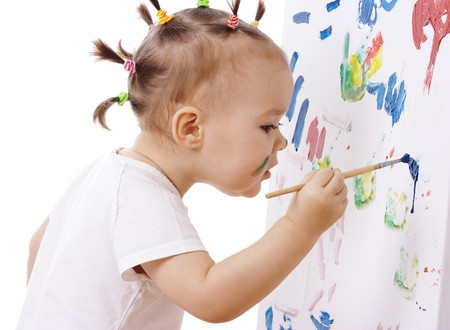 focused: Little girl paint on a board, isolated over white Stock Photo