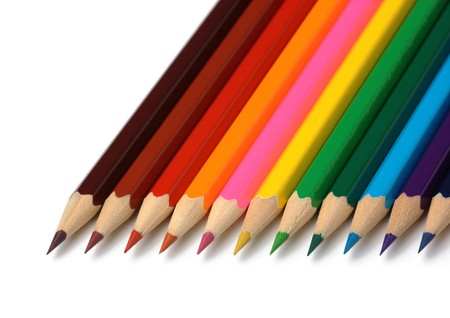Colorful crayons arranged in line, isolated over white photo