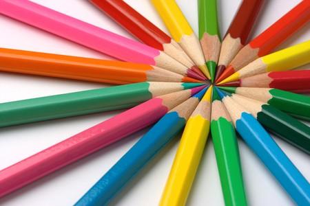 Colorful crayons arranged in circle, macro shoot photo