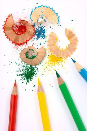 Four sharpened color crayons with shadings on white paper photo