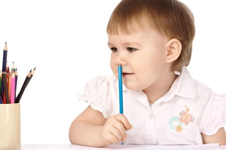 Cute child with blue crayon think about drawings, isolated over white photo
