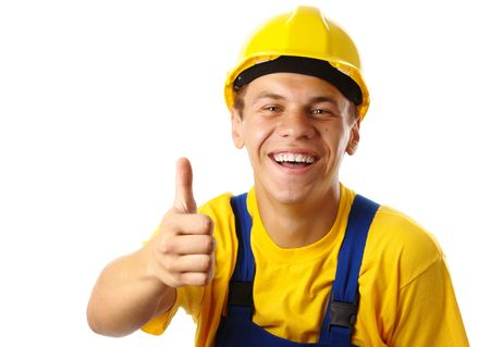 Young construction worker showing thumb up sign, isolated over white photo
