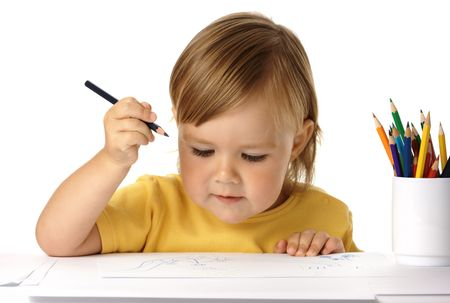 holding arm: Cute child draw with colour crayons, holding arm up evaluating his drawing, isolated over white