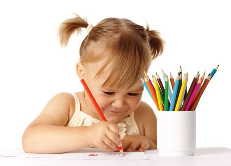 Happy child play with color pencils and smile, isolated over white