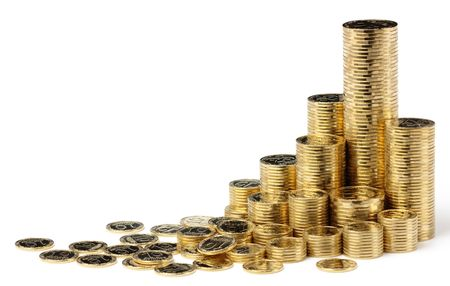 Golden coins arranged in stacks, isolated over white Stock Photo - 5601258