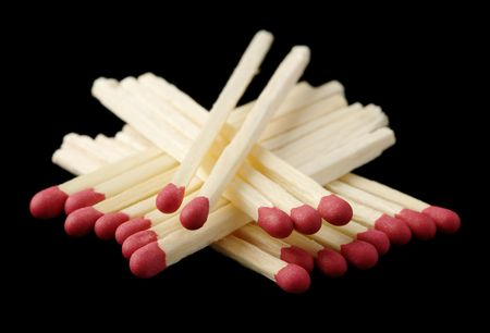 conscription: Red matchsticks, shallow DOF, isolated on black background