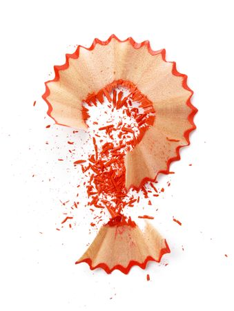 shavings: Question-mark made of red pencil shavings, isolated over white