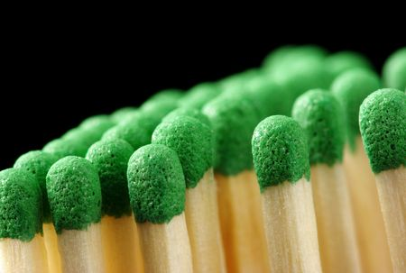 conscription: Green matchsticks, shallow DOF, isolated on black background Stock Photo