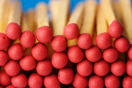 Red matchsticks on blue background, shallow DOF photo