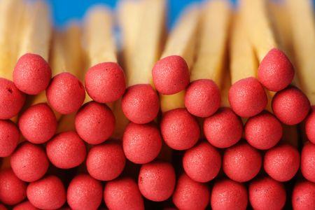 Red matchsticks on blue background, shallow DOF photo