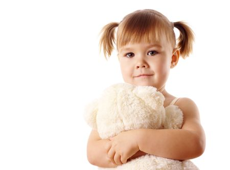 love toys: Cute little girl embracing her teddy bear toy, isolated over white