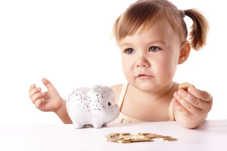 Cute little girl with piggybank, isolated over white photo