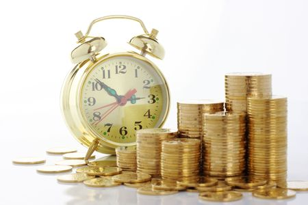Old-fashioned clock dial on golden coins background, time is money concept, isolated over white photo
