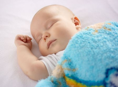 infant hand: Adorable child is sleeping in bed, shallow DOF