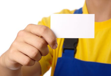 Worker showing his business card, isolated over white photo