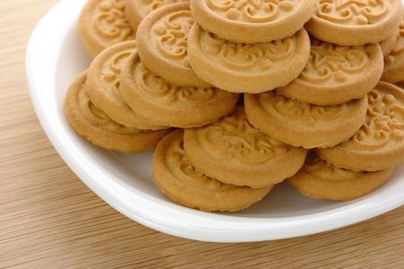 Fresh yellow round cookies on white plate Stock Photo - 6245344