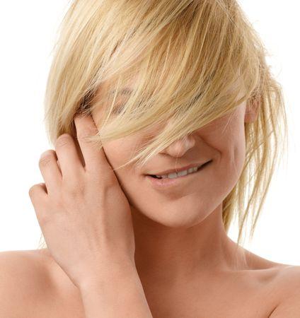 Lovely blonde bites her lip, isolated over white Stock Photo - 6289571