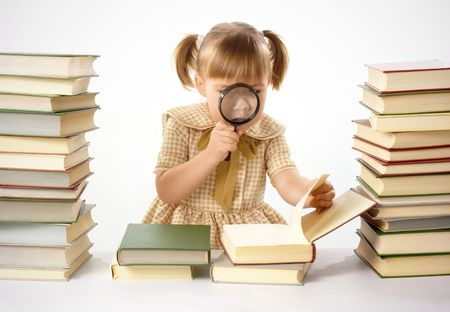 Girl surrounded by books looking at nails using magnifier, isolated over white photo