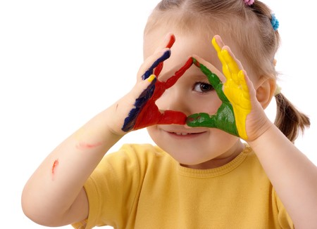 painted hands: Cute cheerful child with painted hands, isolated over white Stock Photo