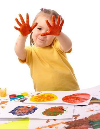 Cute cheerful child paint using hands, isolated over white photo
