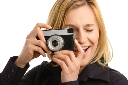 young attractive woman taking a shot with retro photo camera, isolated over white Stock Photo - 7066647