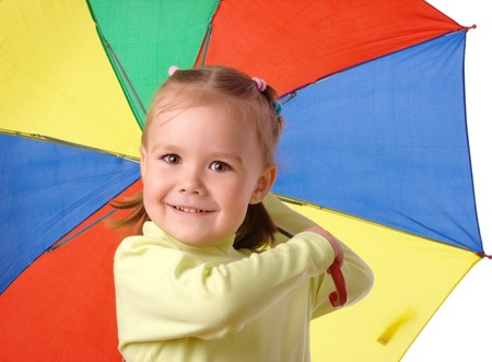 Cute cheerful child with colorful umbrella, isolated over white photo