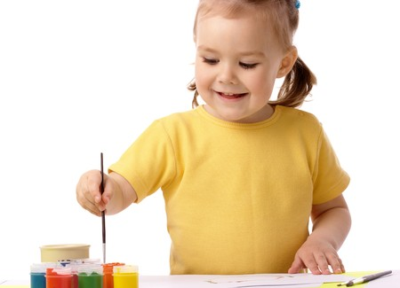 Cute cheerful child play with paints, isolated over white Stock Photo - 7119100
