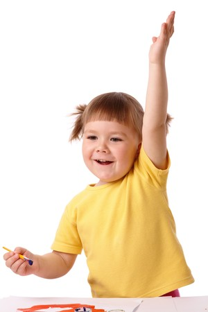Cute cheerful girl with raised hand - ready to give the answer, isolated over white photo