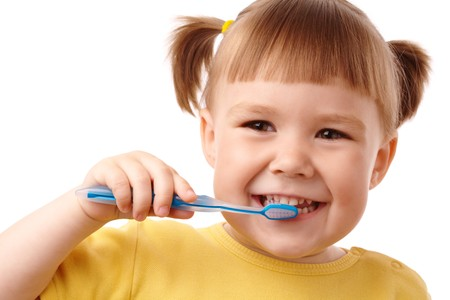 Cute child with toothbrush, isolated over white photo