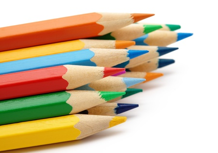 Sharp color crayons, shallow depth of field, isolated over white photo