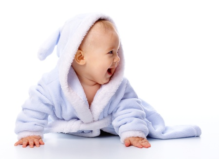 Bright portrait of a cheerful child in blue bathrobe, isolated over white photo