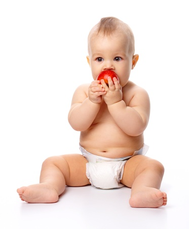 Portrait of a cute little child with red apple, isolated over white photo