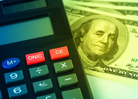 Calculator and few hundred dollars - accounting concept Stock Photo - 8696873