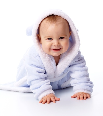 lifestyle looking lovely: Bright portrait of a cheerful child in blue bathrobe, isolated over white