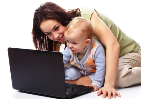 Mother an her little son are playing with laptop, isolated over white photo