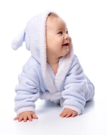 bathrobes: Retrato brillante de un ni�o alegre en azul albornoz, aislado en blanco