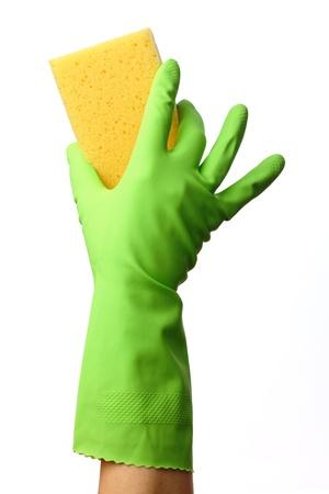 higienizar: Hand in glove holding washing sponge, isolated over white Banco de Imagens
