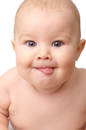 Happy toddler smiling, sticking his tongue out, isolated over white Stock Photo - 8795250