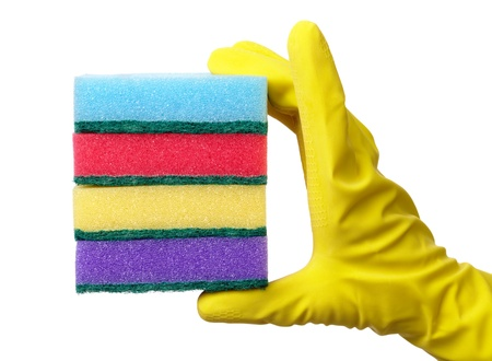 Hand in glove holding few washing sponges - amount of housework concept, isolated over white photo