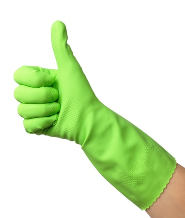 endorsement: Hand wearing green rubber glove shows thumb up sign, isolated over white