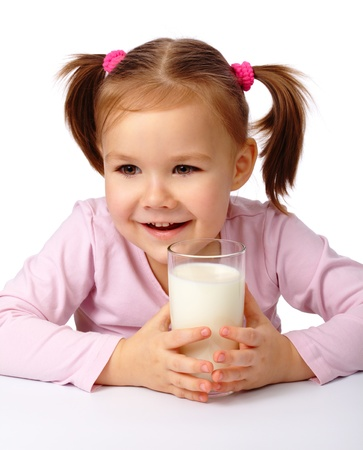 Cute little girl with a glass of milk, isolated over white Stock Photo - 8795248