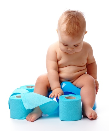 poo: Child on potty play with toilet paper, isolated over white