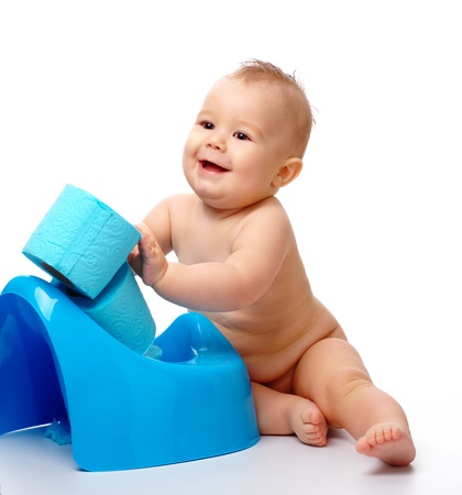 Child on potty play with toilet paper, isolated over white Stock Photo - 8964028