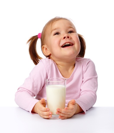 Cute little girl with a glass of milk, isolated over white Stock Photo - 8964025