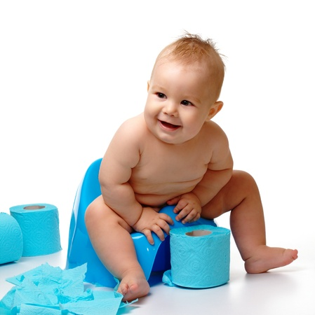 girl toilet: Child on potty play with toilet paper, isolated over white