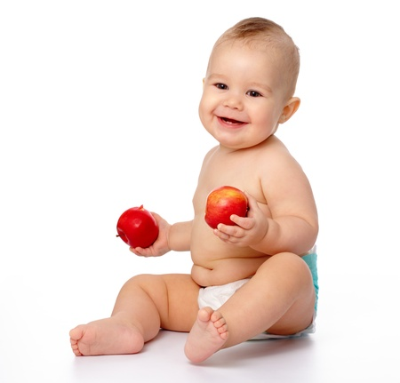 Portrait of a cute little child with two red apples, isolated over white Stock Photo - 8964097