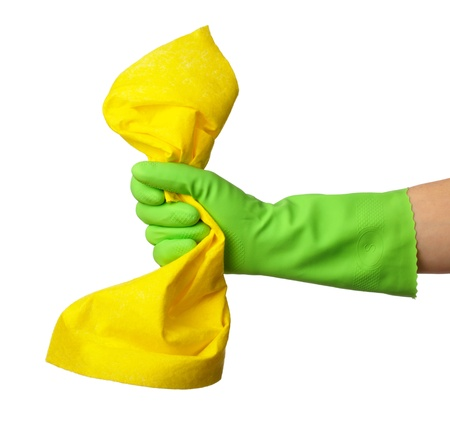 Hand in green rubber glove holds a yellow rag - house cleaning concept, isolated over white photo