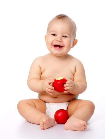 Portrait of a cute little child with two red apples, isolated over white photo