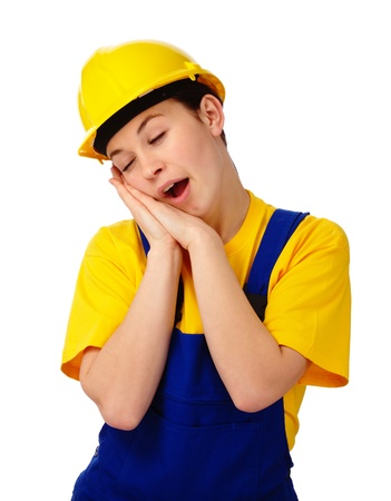 Young woman in construction uniform is yawning, isolated over white photo
